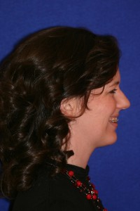 Profile view, smiling.